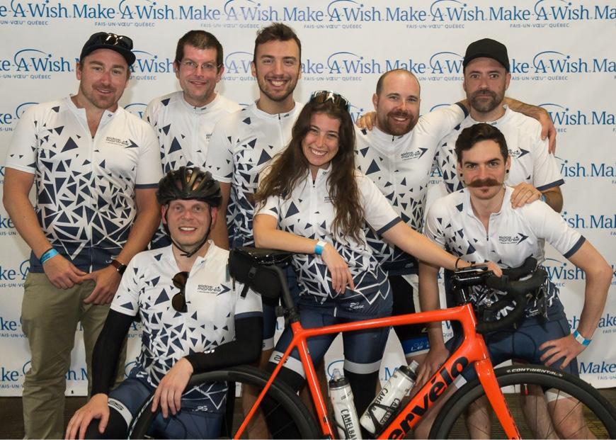 Eidos-Montréal employees attending a charity biking event, wearing cycling clothes